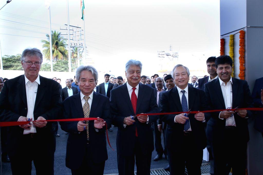 Bidadi: Wipro Chairman Azim Premji unveils the new plant of Wipro-Kawasaki joint venture to manufacture hydraulic pumps and motors for the construction machinery at Karnataka's Bidadi near Bengaluru on Feb 18, 2019. (Photo: IANS)