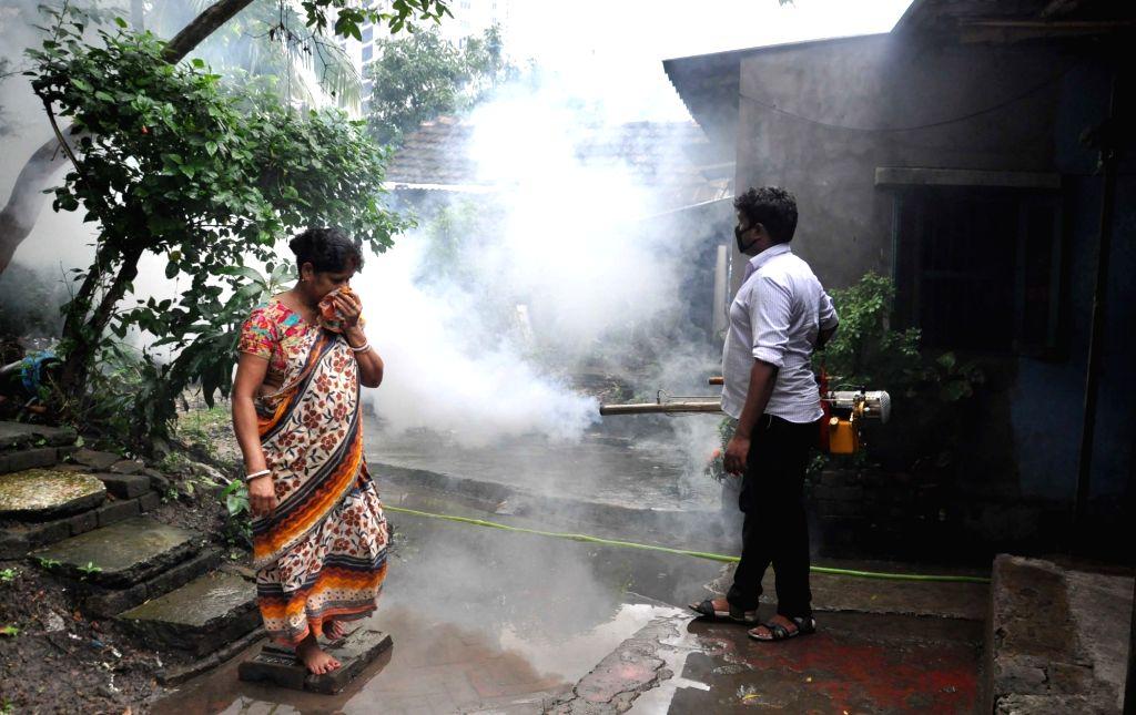 Bidhannagar Municipal Corporation (BMC) workers fumigate to kill mosquitoes at Salt Lake's Duttabad, in Kolkata on Sept 3, 3018.
