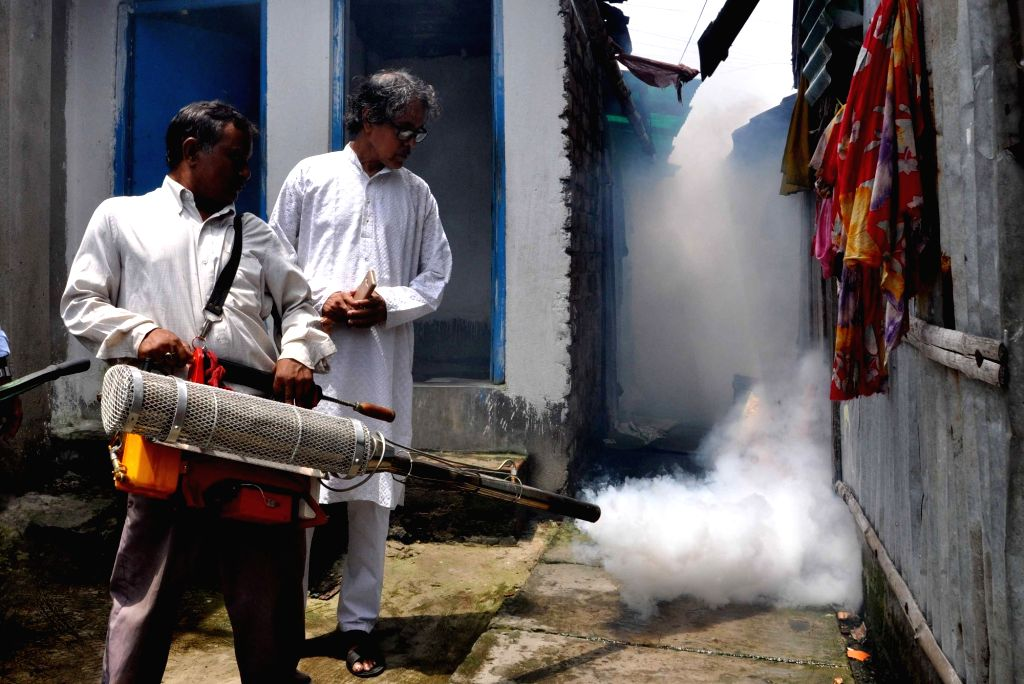 Bidhannagar Municipality staff fumigate to curb mosquito-borne diseases at Keshtopur canal in Kolkata on Aug 9, 2017.