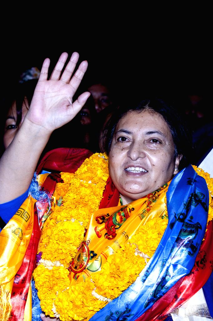 Bidhya Devi Bhandari, Vice Chairperson of the Communist Party of Nepal (Unified Marxist-Leninist), gestures after winning the election at the ...