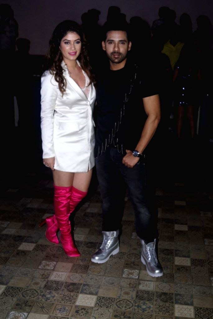 "Bigg Boss 11 contestants Puneesh Sharma and Bandgi Kalra at the launch of music composer-singer duo Manmeet Singh and Harmeet song ""Love Me"" in Mumbai on Aug 6, 2018. - Puneesh Sharma and Manmeet Singh"