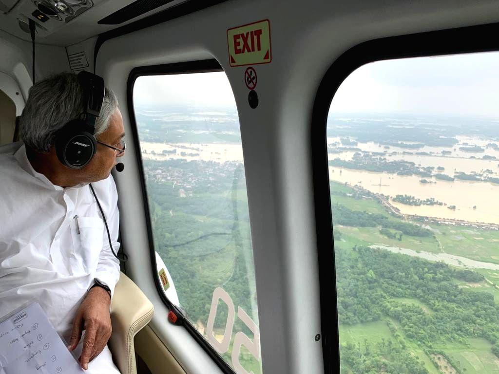 Bihar: Bihar Chief Minister Nitish Kumar conducts an aerial survey of the flood-hit areas in Bihar on July 14, 2019. (Photo: IANS) - Nitish Kumar