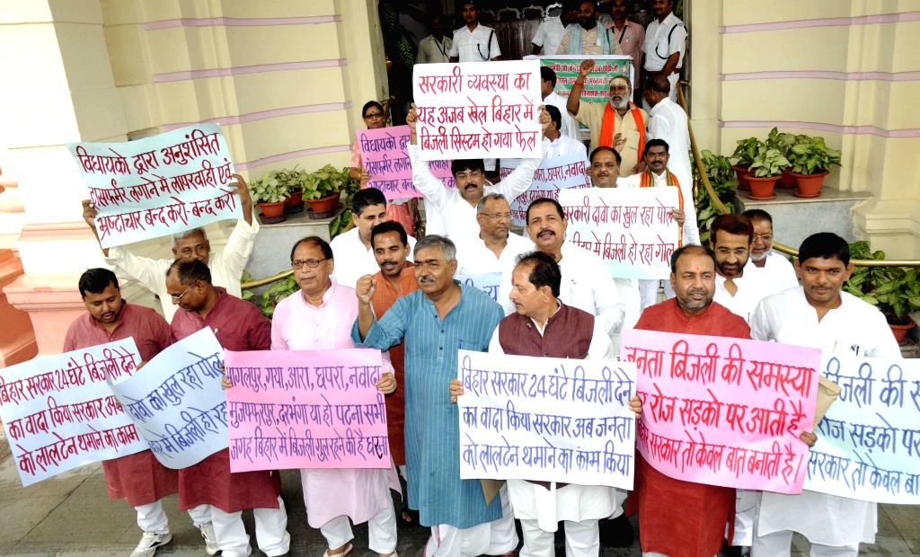 Bihar BJP legislators demonstrate against shortage of electricity in the state in Patna on July 1, 2014.