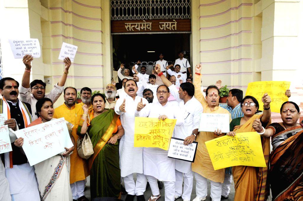 Bihar BJP legislators demonstrate against Rohtas firing at Bihar Legislative Assembly in Patna on July 10, 2014.