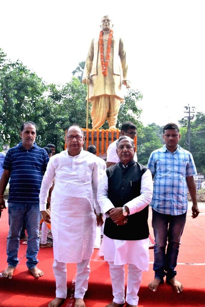 Bihar Cabinet Minister Nand Kishore Yadav during a programme organised to commemorate the birth anniversary of Indian poet Ramdhari Singh Dinkar, in Patna on Sep 23, 2019. - Nand Kishore Yadav and Ramdhari Singh Dinkar