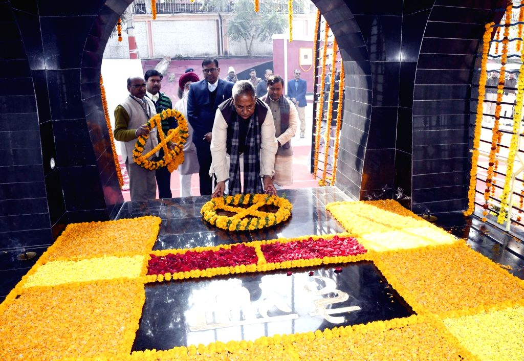 Bihar Cabinet Minister Nand Kishore Yadav pays tributes to Mahatma Gandhi on his death anniversary at Gandhi Ghat in Patna, on Jan 30, 2019. - Nand Kishore Yadav