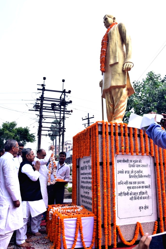 Bihar Cabinet Minister Nand Kishore Yadav pays tributes to Indian poet Ramdhari Singh Dinkar on his birth anniversary, in Patna on Sep 23, 2019. - Nand Kishore Yadav and Ramdhari Singh Dinkar
