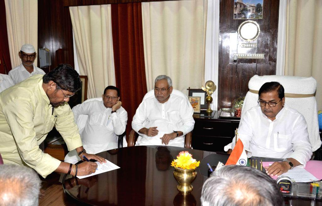 Bihar Cabinet Minister Pashupati Kumar Paras takes oath as MLC in the presence of Chief Minister Nitish Kumar in Patna on Sept 11, 2017. - Pashupati Kumar Paras and Nitish Kumar