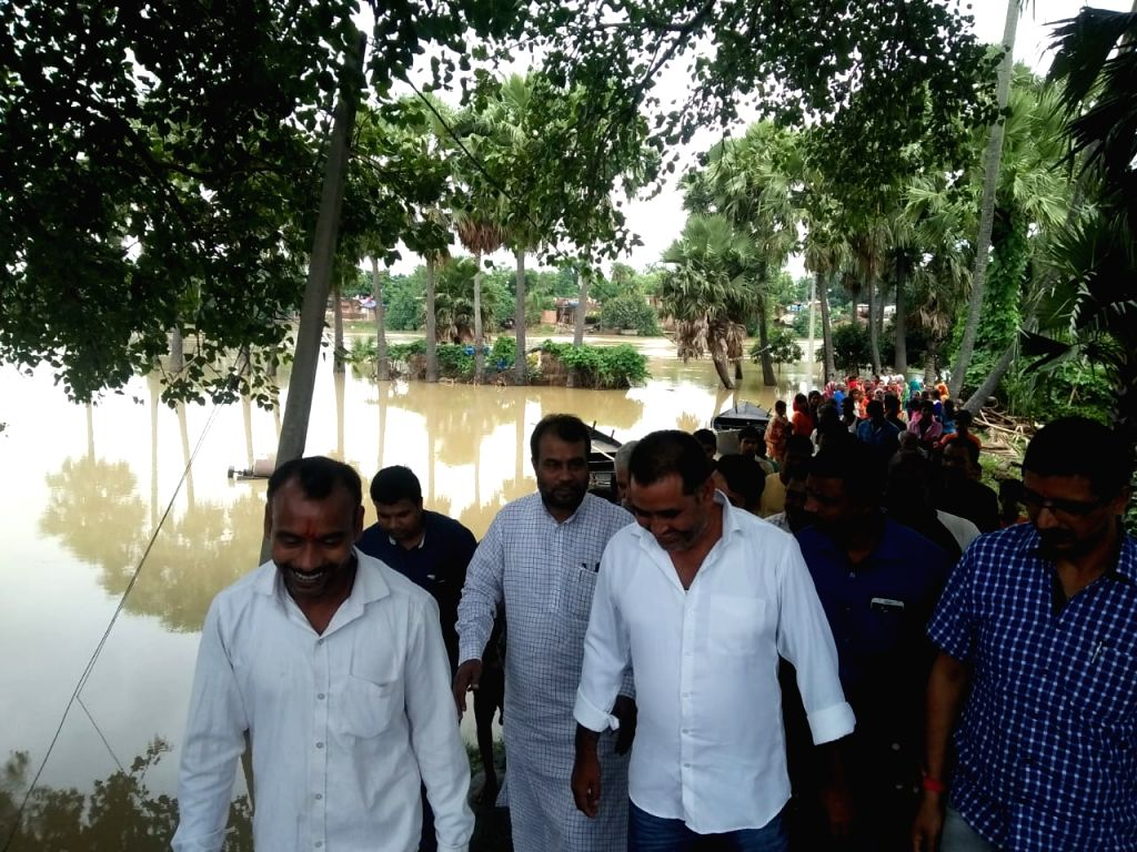 Bihar Cabinet Minister Shyam Rajak takes stock of the situation during his visit to the flood affected Phulwari Sharif district of Bihar, on Sep 30, 2019. - Shyam Rajak