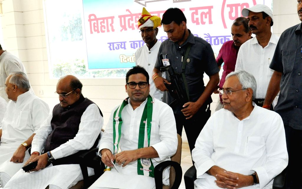 Bihar Chief Minister and JD-U chief Nitish Kumar with election strategist Prashant Kishor during a programme where the latter joined JD-U, in Patna on Sept 16, 2018. Kishor, 41-year-old former ... - Nitish Kumar