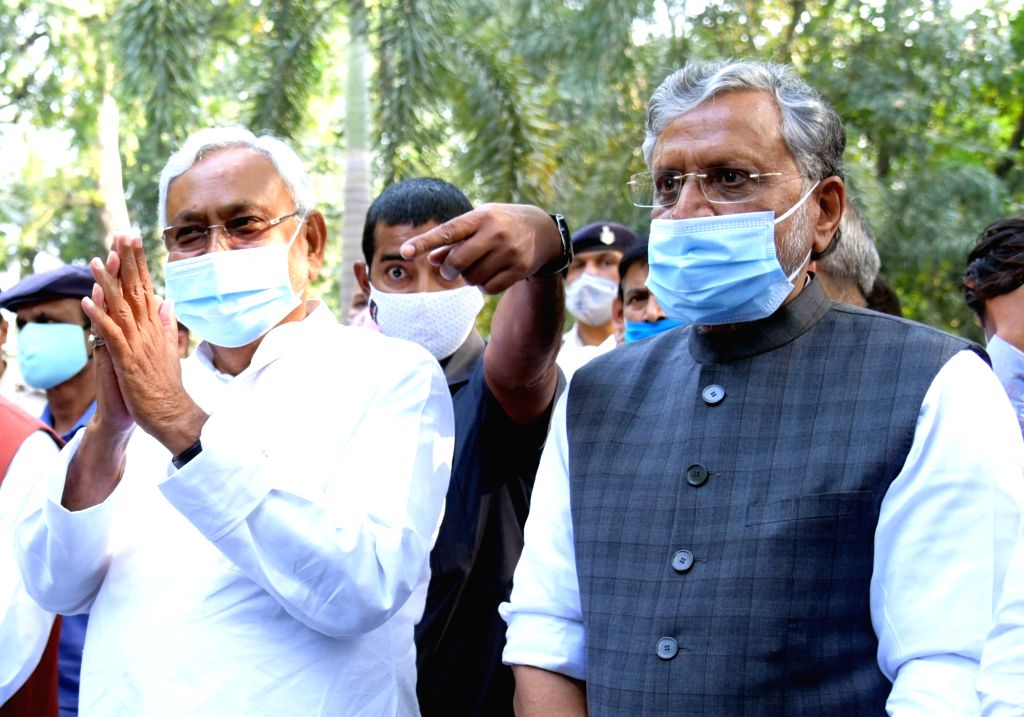 Bihar Chief Minister and JD-U National President Nitish Kumar and Deputy Chief Minister and BJP leader Sushil Kumar Modi leave after attending NDA meeting in Patna, on Nov 13, 2020. - Nitish Kumar and Sushil Kumar Modi