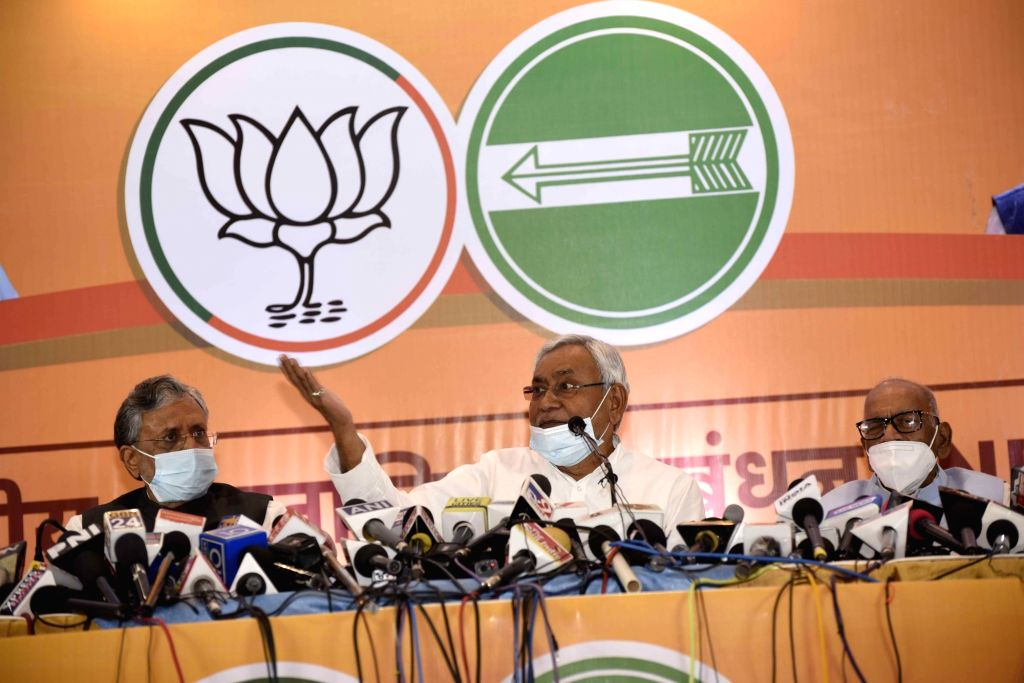 Bihar Chief Minister and JD-U President Nitish Kumar accompanied by Deputy Chief Minister and BJP leader Sushil Kumar Modi, addresses a press conference held by NDA parties ahead of Bihar ... - Nitish Kumar and Sushil Kumar Modi