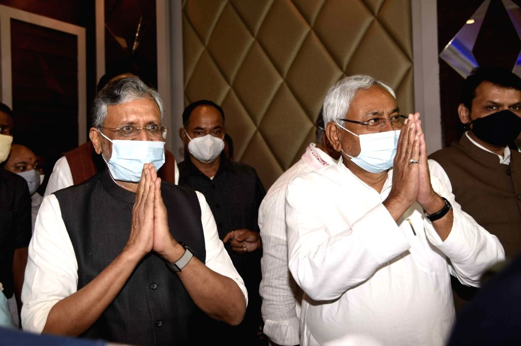 Bihar Chief Minister and JD-U President Nitish Kumar and Deputy Chief Minister and BJP leader Sushil Kumar Modi arrive to address a press conference held by NDA parties ahead of Bihar Assembly ... - Nitish Kumar and Sushil Kumar Modi