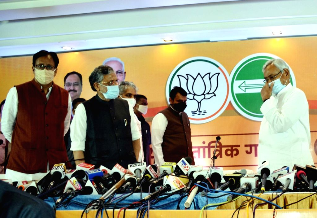 Bihar Chief Minister and JD-U President Nitish Kumar, Deputy Chief Minister and BJP leader Sushil Kumar Modi, Bihar BJP President Sanjay Jaiswal and party's Bihar election in-charge Devendra ... - Nitish Kumar and Sushil Kumar Modi