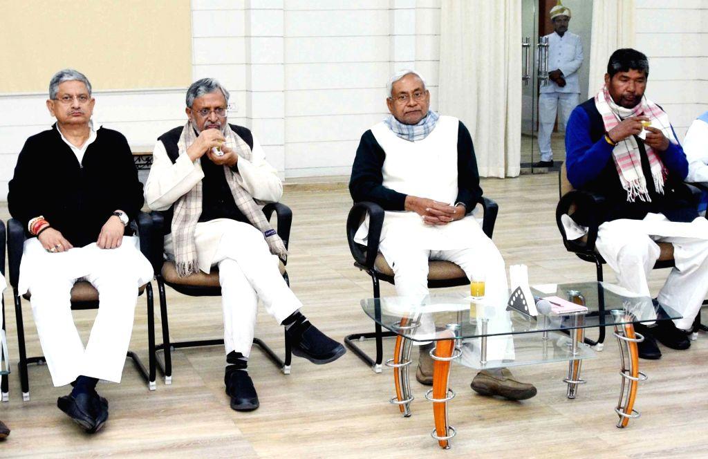 Bihar Chief Minister and JD (U) President Nitish Kumar, Bihar Deputy Chief Minister and BJP leader Sushil Kumar Modi, LJP chief Pashupati Kumar and others at NDA meeting in Patna on Feb 11, ... - Nitish Kumar, Sushil Kumar Modi and Pashupati Kumar