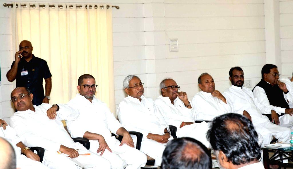 Bihar Chief Minister and JD-U President Nitish Kumar, party's Vice President Prashant Kishor, JD(U) leader KC Tyagi during party's national executive meeting, in Patna, on June 9, 2019. - Nitish Kumar