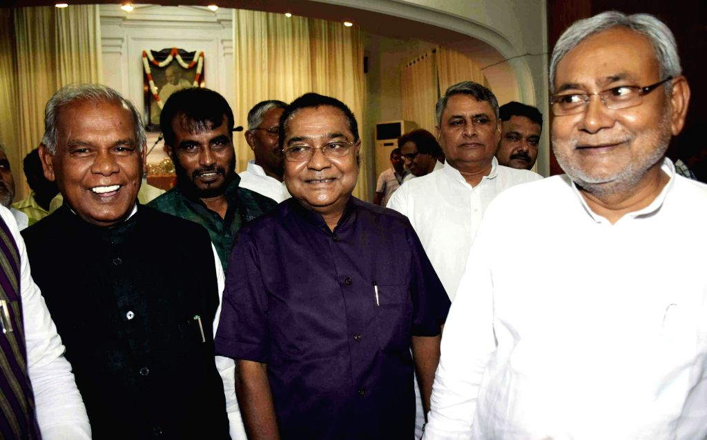 Bihar Chief Minister Jitan Ram Majhi and former Bihar Chief Minister and JD-U leader Nitish Kumar with the newly appointed Information Commissioner of Bihar, Arun Kumar Verma at Raj Bhavan in Patna .. - Jitan Ram Majhi and Nitish Kumar