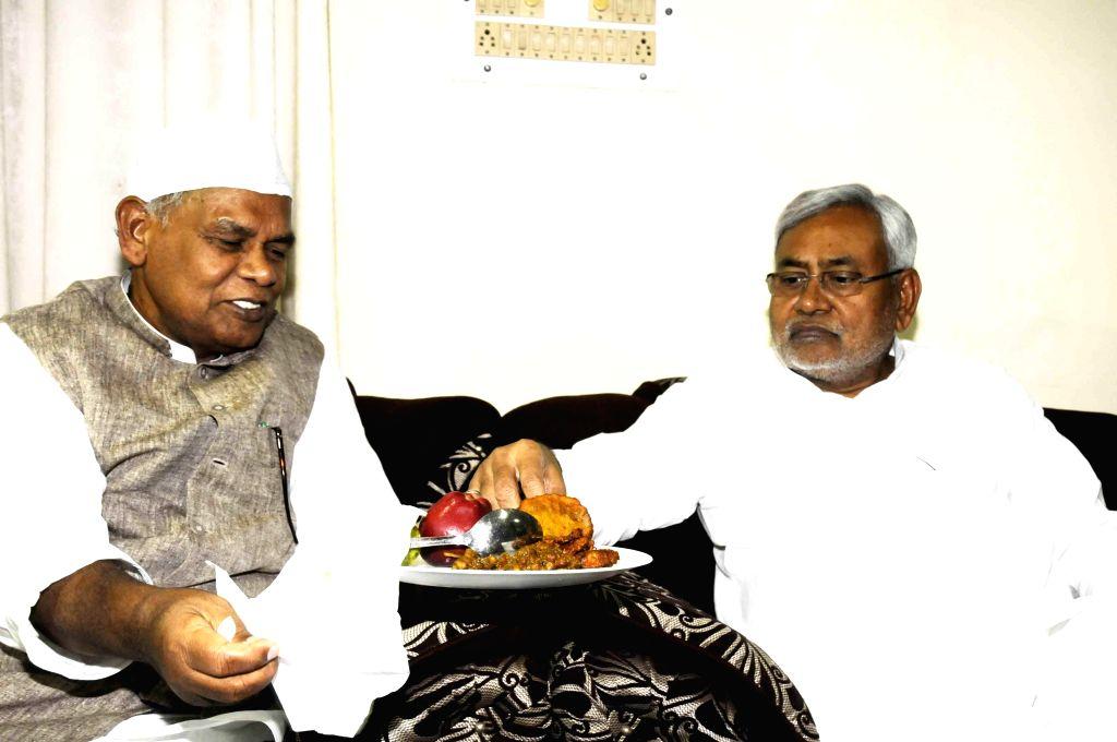 Bihar Chief Minister Jitan Ram Majhi with former Bihar Chief Minister Nitish Kumar during Iftar party at his residence in Patna on July 23, 2014. - Jitan Ram Majhi and Nitish Kumar