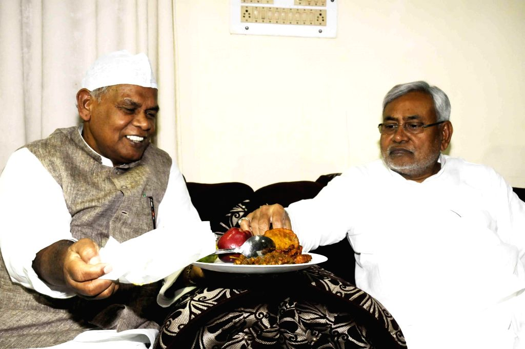 Bihar Chief Minister Jitan Ram Majhi with former Bihar Chief Minister Nitish Kumar during Iftar party at his residence in Patna on July 23, 2014. - Jitan Ram Majhi and Nitish Kumar