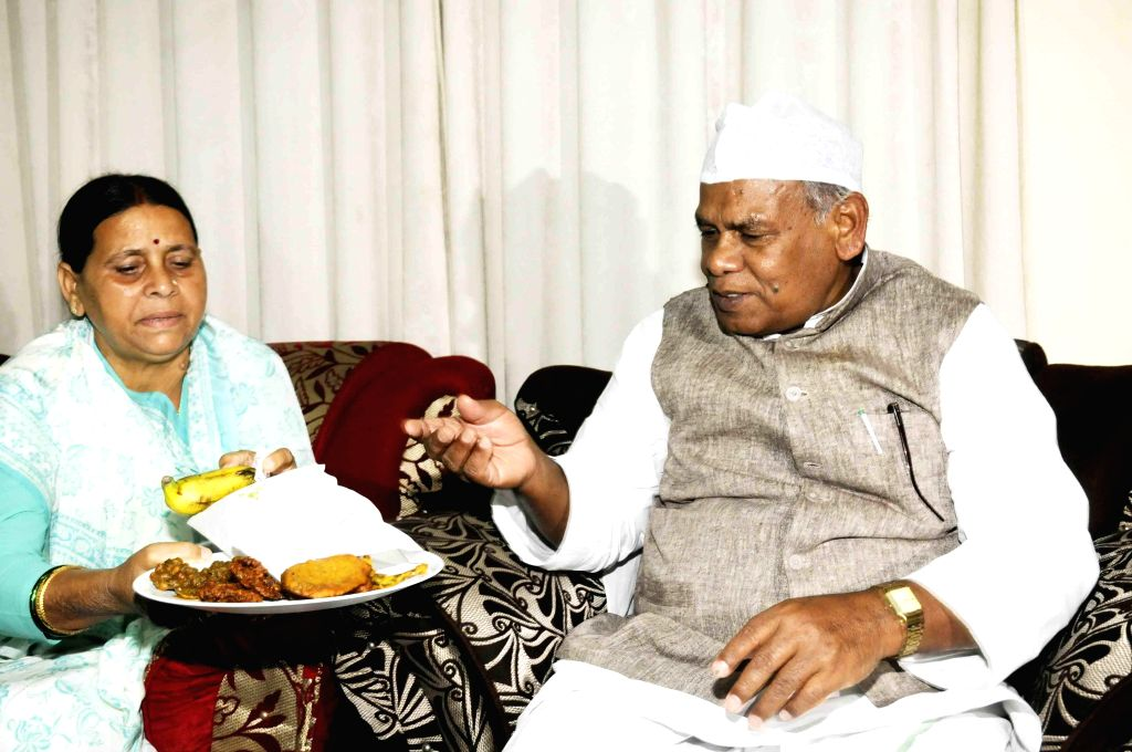 Bihar Chief Minister Jitan Ram Majhi with former Bihar Chief Minister Rabri Devi during Iftar party at his residence in Patna on July 23, 2014. - Jitan Ram Majhi