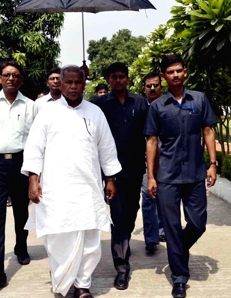 Bihar Chief Minister Jitan Ram Manjhi meeting people during a janta darbar in Patna on June 16, 2014.