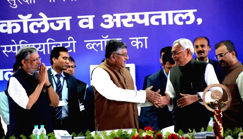 Bihar Chief Minister Nitih Kumar, Union Law Minister Ravi Shankar Prasad, Bihar Deputy Chief Minister Sushil Kumar Modi during a programme at Patna Medical College and Hospital (PMCH) on March ... - Nitih Kumar and Sushil Kumar Modi