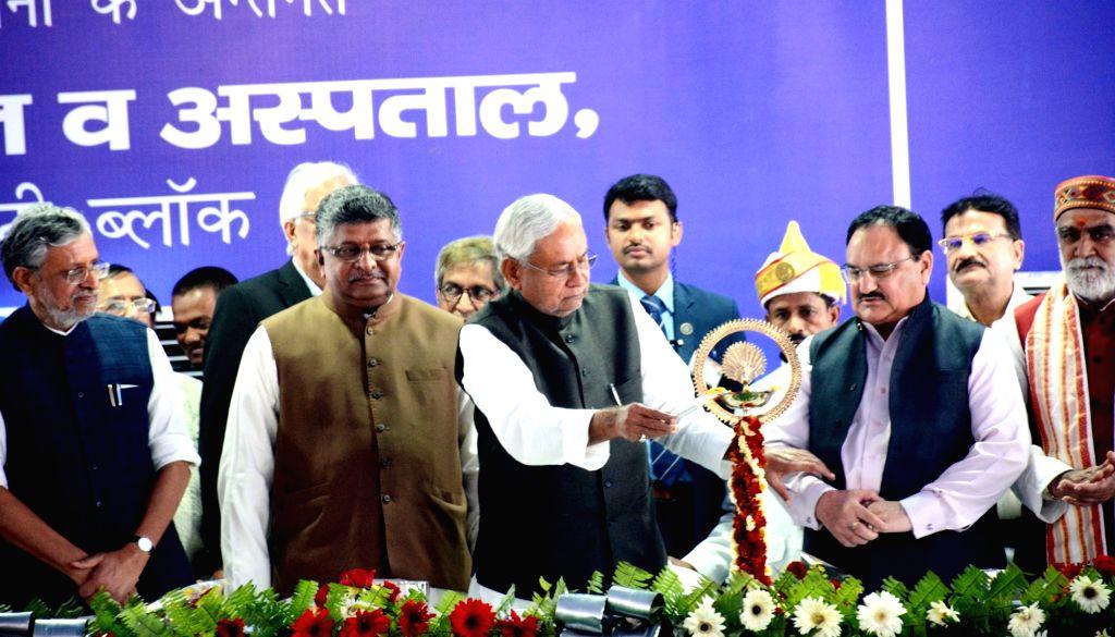 Bihar Chief Minister Nitih Kumar with Union Ministers Ravi Shankar Prasad and JP Nadda and Bihar Deputy Chief Minister Sushil Kumar Modi during a programme at Patna Medical College and ... - Nitih Kumar, Ravi Shankar Prasad, J and Sushil Kumar Modi