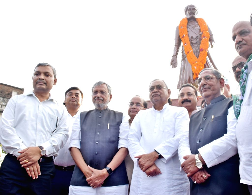 Bihar Chief Minister Nitish Kumar accompanied by Deputy Chief Minister Sushil Kumar Modi and Cabinet Minister Nand Kishore Yadav, unveils the statue of Bhamashah, in Patna on Sep 23, 2019. - Nitish Kumar, Sushil Kumar Modi and Nand Kishore Yadav