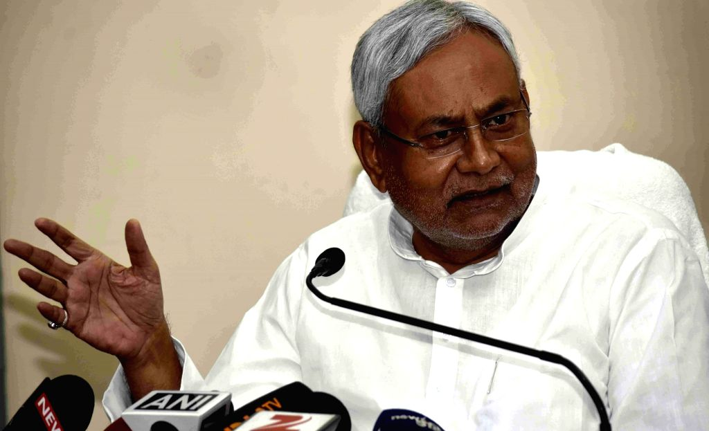 Bihar Chief Minister Nitish Kumar addresses a press conference in Patna on April 18, 2016. - Nitish Kumar