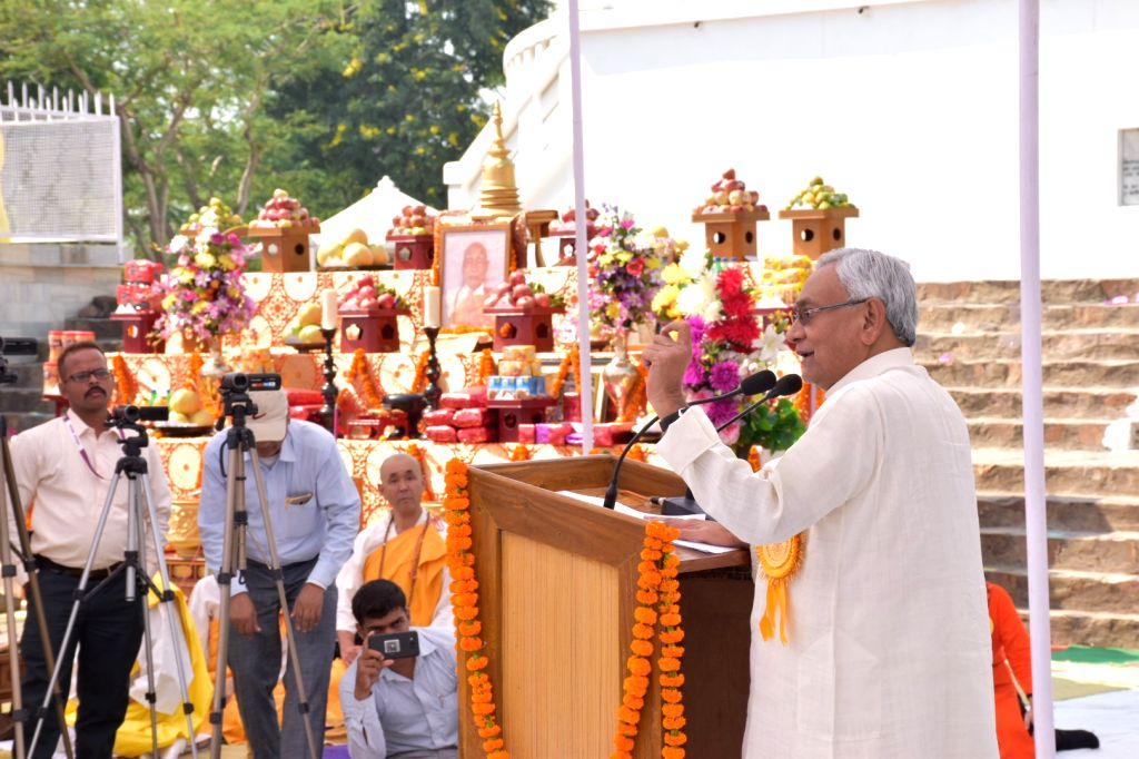 Bihar Chief Minister Nitish Kumar addresses a gathering during a programme organised on the 49th Annual Ceremony of the Viswa Shanti Stupa in Bihar's Rajgir on Oct 25, 2018. - Nitish Kumar
