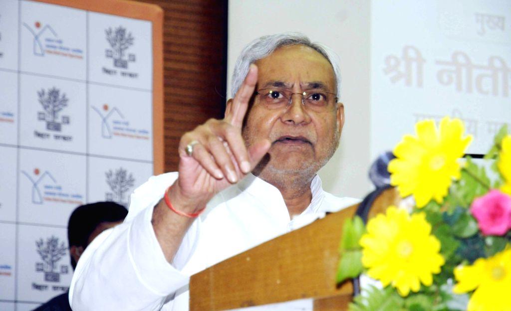 Bihar Chief Minister Nitish Kumar addresses on Pradhan Mantri Awas Yojana during a programme, in Patna, on July 27, 2018. - Nitish Kumar