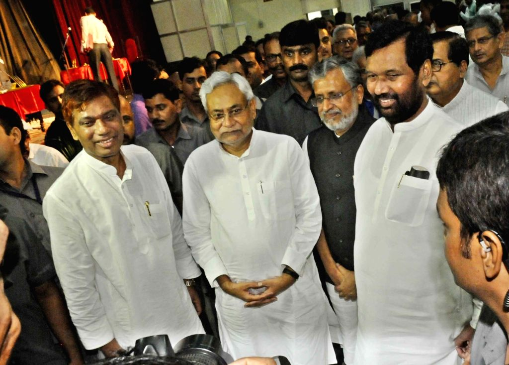 Bihar Chief Minister Nitish Kumar along with Bihar Deputy Chief Minister Sushil Kumar Modi and Union Minister Ram Vilas Paswan during the swearing in ceremony of Bihar's cabinet ministers at ... - Nitish Kumar and Sushil Kumar Modi