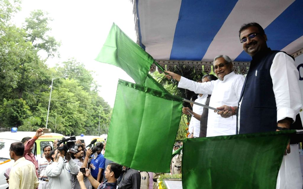 Bihar Chief Minister Nitish Kumar along with Bihar Health Minister Mangal Pandey flag off the ambulance services in Patna on Aug 12, 2017. - Nitish Kumar and Mangal Pandey