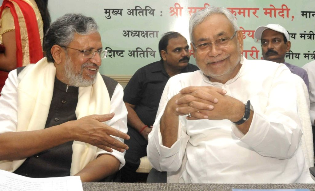 Bihar Chief Minister Nitish Kumar along with Deputy Chief Minister Sushil Kumar Modi during a programme in Patna on Oct 10, 2017. - Nitish Kumar and Sushil Kumar Modi