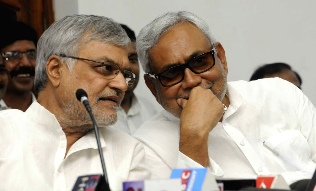 Bihar Chief Minister Nitish Kumar and Congress leader C. P. Joshi during a press conference in Patna on Aug 12, 2015. - Nitish Kumar and C. P. Joshi