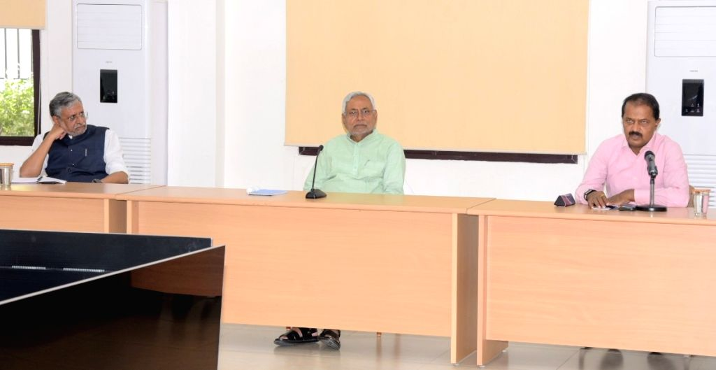 Bihar Chief Minister Nitish Kumar and Deputy Chief Minister Sushil Kumar Modi preside over a meeting to review the problems faced by migrant workers stuck in Bihar and that of Bihari migrant ... - Nitish Kumar and Sushil Kumar Modi
