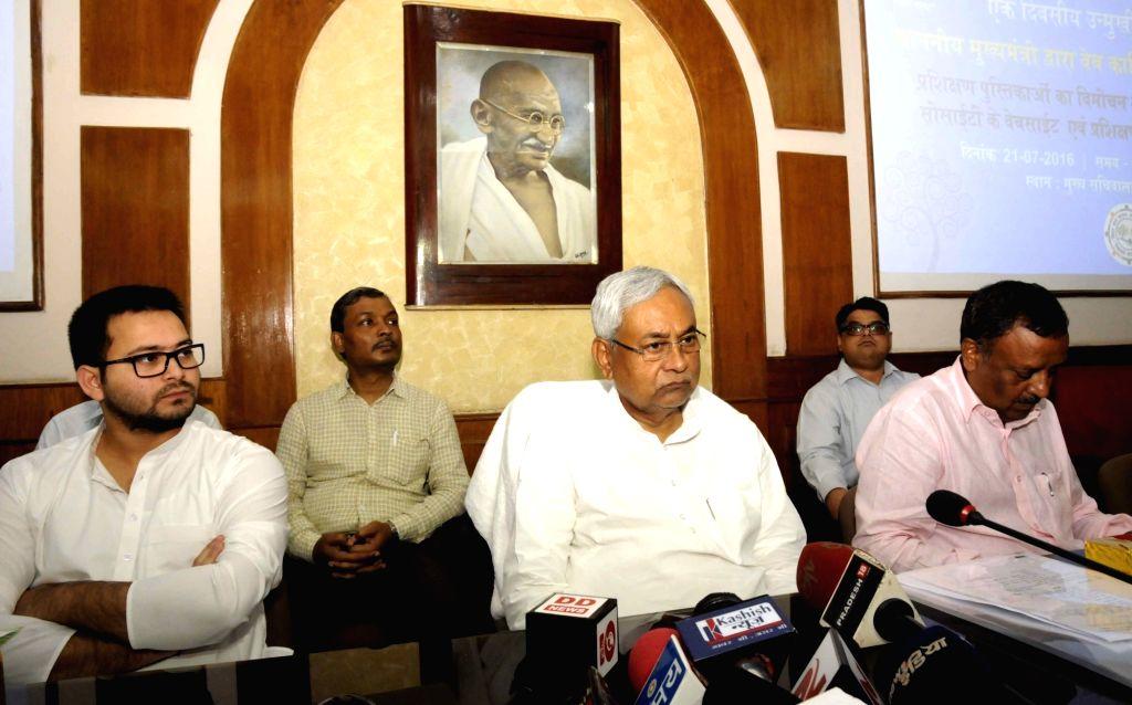 Bihar Chief Minister Nitish Kumar and Deputy Chief Minister Tejashwi Yadav during a programme organised by Panchayati Raj in Patna on July 21, 2016. - Nitish Kumar and Tejashwi Yadav