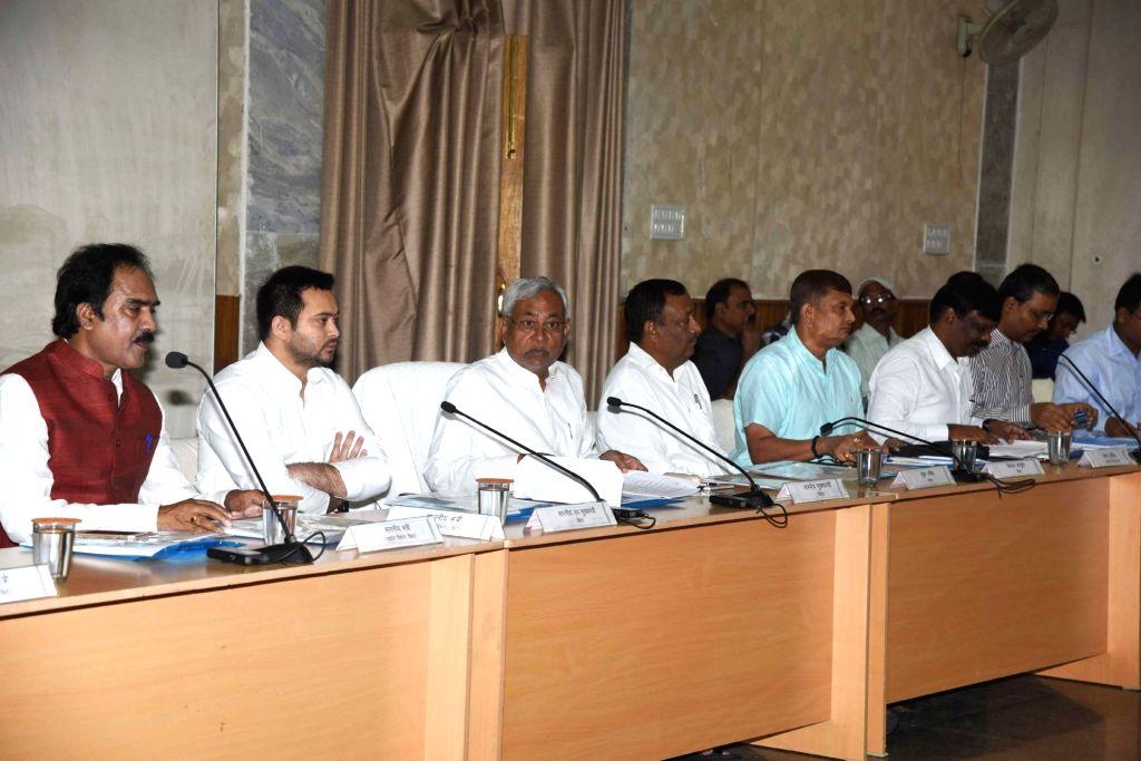 Bihar Chief Minister Nitish Kumar and Deputy Chief Minister Tejaswi Yadav during Udyami Panchayat meeting in Patna on Oct 31, 2016. - Nitish Kumar and Tejaswi Yadav