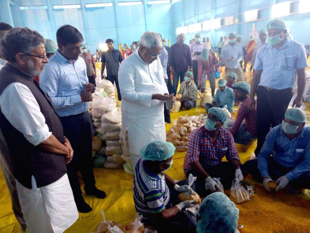 Bihar Chief Minister Nitish Kumar and Deputy Chief Minister Sushil Kumar Modi inspects a flood relief camp in Patna on Aug 17, 2017. - Nitish Kumar and Sushil Kumar Modi