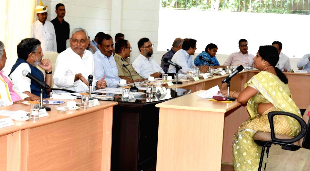 Bihar Chief Minister Nitish Kumar and Deputy Chief Minister Sushil Kumar Modi during the 'Lok Samvad' programme in Patna on Sept 18, 2017. - Nitish Kumar and Sushil Kumar Modi