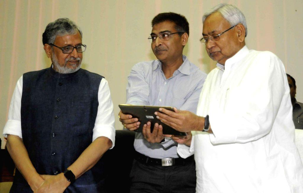 Bihar Chief Minister Nitish Kumar and Deputy Chief Minister Sushil Kumar Modi during a programme in Patna on April 5, 2018. - Nitish Kumar and Sushil Kumar Modi