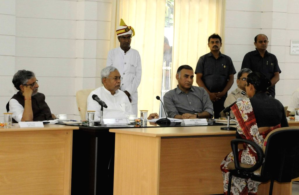Bihar Chief Minister Nitish Kumar and Deputy Chief Minister Sushil Kumar Modi listen to the public's grievances during Lok Samvad programme, in Patna on July 16, 2018. - Nitish Kumar and Sushil Kumar Modi