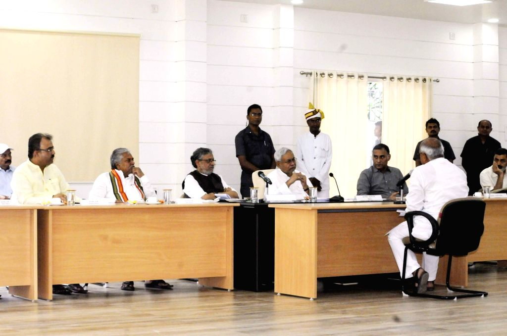 Bihar Chief Minister Nitish Kumar and Deputy Chief Minister Sushil Kumar Modi listen to the public's grievances along with state cabinet ministers Mangal Pandey and Prem Kumar during Lok ... - Nitish Kumar, Sushil Kumar Modi, Mangal Pandey and Prem Kumar