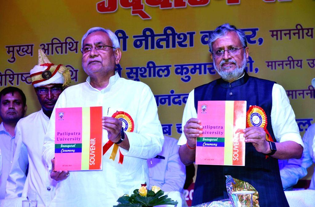 Bihar Chief Minister Nitish Kumar and Deputy Chief Minister Sushil Kumar Modi during a programme, in Patna on July 30, 2018. - Nitish Kumar and Sushil Kumar Modi