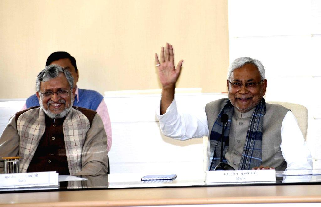 Bihar Chief Minister Nitish Kumar and Deputy Chief Minister Sushil Kumar Modi talk to media persons during 'Lok Samvad' programme in Patna, on Feb 4, 2019. - Nitish Kumar and Sushil Kumar Modi