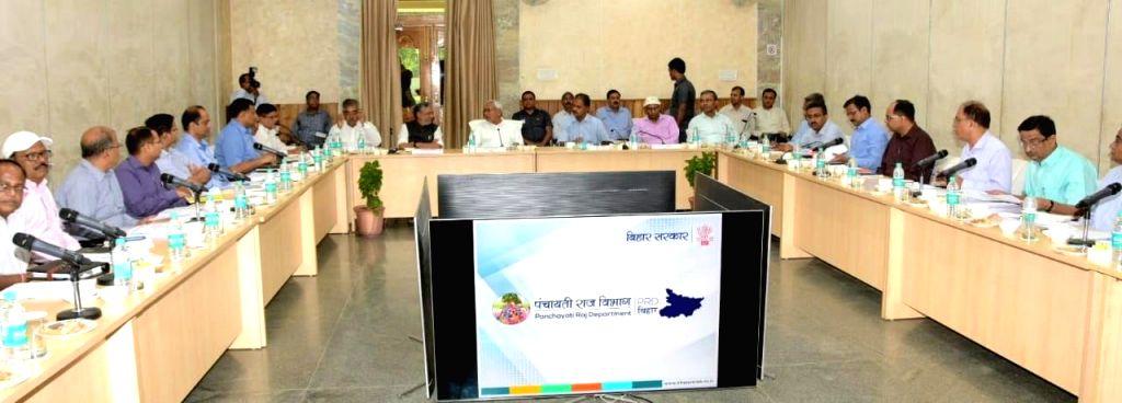 Bihar Chief Minister Nitish Kumar and Deputy Chief Minister Sushil Kumar Modi chair a review meeting of the Panchayati Raj Department, in Patna on June 1, 2019. - Nitish Kumar and Sushil Kumar Modi