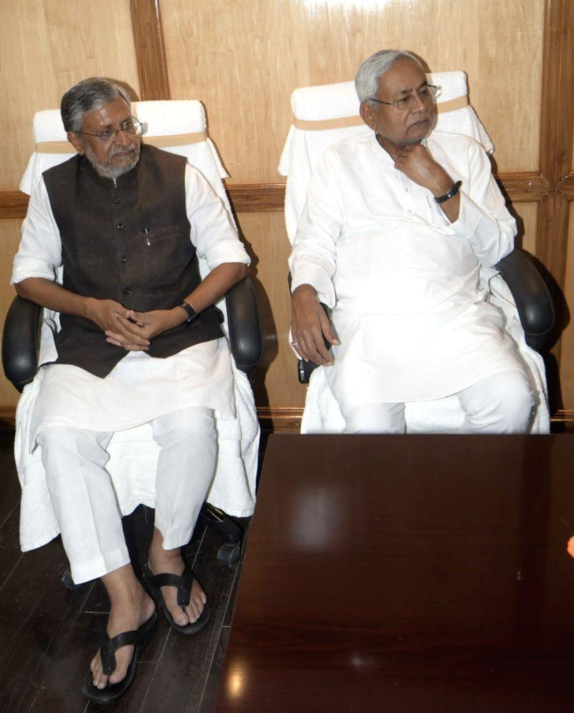 Bihar Chief Minister Nitish Kumar and Deputy Chief Minister Sushil Kumar Modi at the oath taking ceremony of newly elected BJP MLC Radha Mohan Sharma and JD-U MLC Sanjay Jha, in Patna on June ... - Nitish Kumar, Sushil Kumar Modi and Radha Mohan Sharma