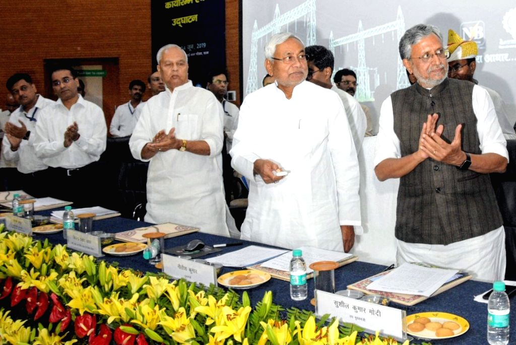 Bihar Chief Minister Nitish Kumar and Deputy Chief Minister Sushil Kumar Modi at the launch of various state government schemes, in Patna on June 4, 2019. - Nitish Kumar and Sushil Kumar Modi