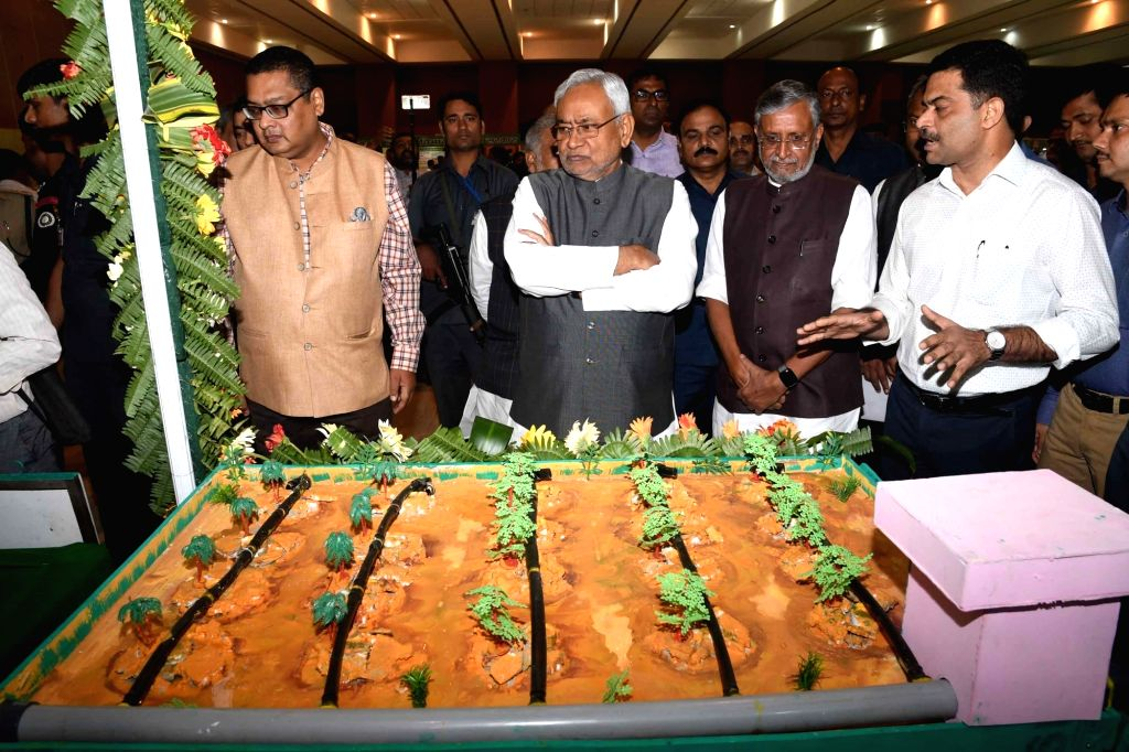 Bihar Chief Minister Nitish Kumar and Deputy Chief Minister Sushil Kumar Modi visit an exhibition organised by the state's Minor Water Resources Department, in Patna on Oct 26, 2019. - Nitish Kumar and Sushil Kumar Modi