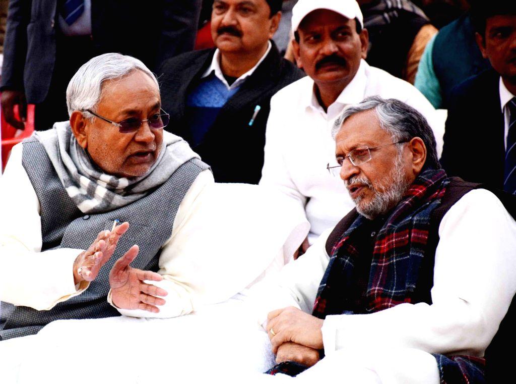 Bihar Chief Minister Nitish Kumar and Deputy Chief Minister Sushil Kumar Modi during the birth anniversary celebrations of Former Bihar Chief Minister Late Karpoori Thakur, in Patna on Jan 24, ... - Nitish Kumar and Sushil Kumar Modi